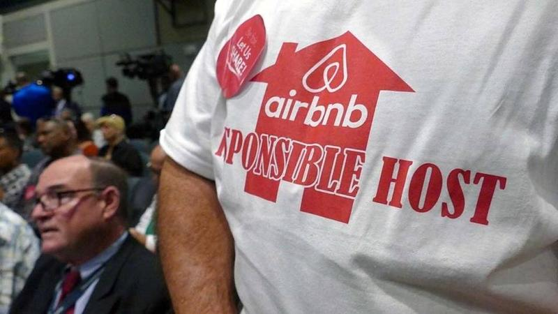 An Airbnb supporter waits his turn to speak at the Miami commission meeting last month discussing Airbnb .