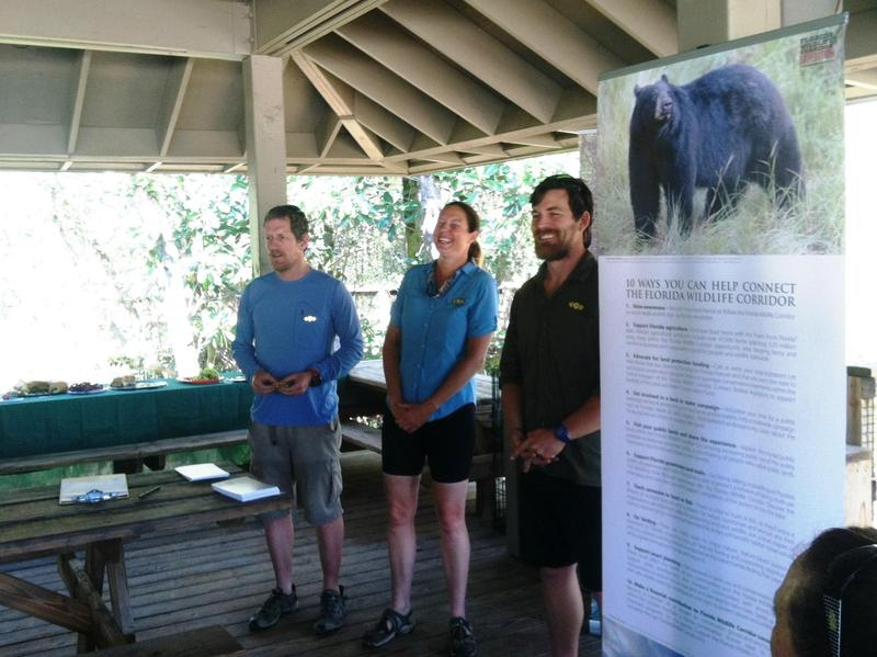 Expeditioners Carlton Ward Jr., Mallory Lykes Dimmitt and Joe Guthrie at a pavilion at Blackwater River State Park