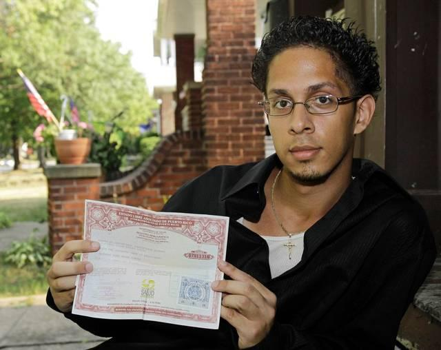 In this photograph from 2010, Alfredo Pagan shows his Puerto Rican birth certificate.