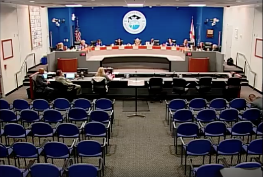 A screenshot of the Broward County School Board meeting just as public comment period was set to begin shows an auditorium full of empty chairs.
