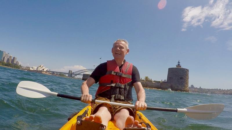 Martin kayaks in Sydney Harbor