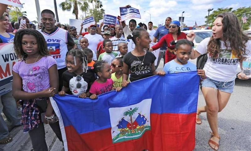 Haitian and immigration advocates held a rally in front of U.S. Citizenship and Immigration Services office in Miami on Saturday, May 13, 2017.