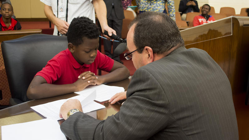 Attorney James Carlson rehearsed oral arguments with Brownsville student Juan Dykes