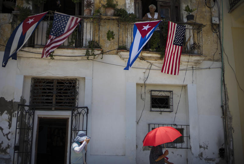 Cuban and U.S. flags hang from a resident's balcony on the day the U.S. opened its embassy in Havana, Cuba, Friday, Aug. 14, 2015. During his campaign, then-candidate Trump promised to change Cuba policy.
