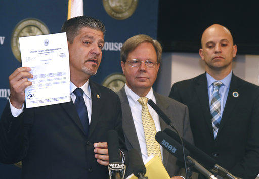 Florida Rep. Bob Cortes, R-Altamonte Springs, holds up a letter he sent Gov. Rick Scott in support of a reassignment of 21 first-degree murder cases from State Attorney Aramis Ayala's office during a press conference Tuesday, April 4, 2017.