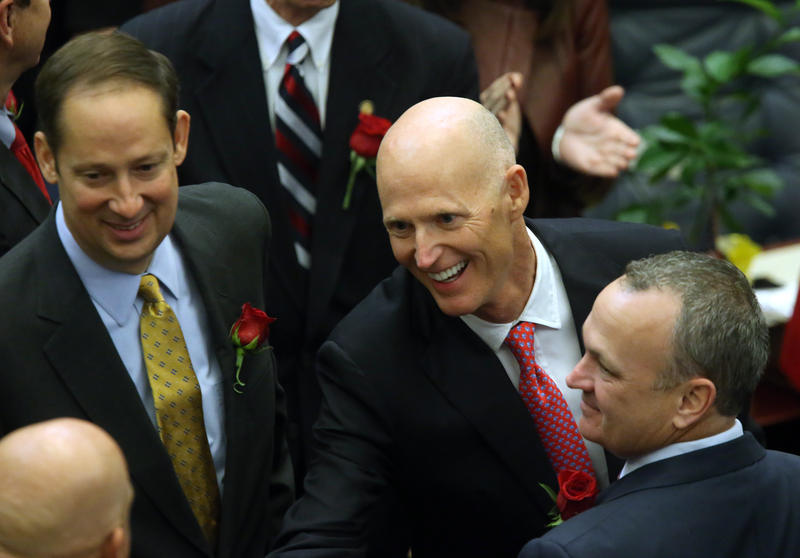 Gov. Rick Scott flanked by Sen. Joe Negron, R-Stuart, left, and Rep. Richard Corcoran, R-Land O' Lakes in 2016 in Tallahassee.