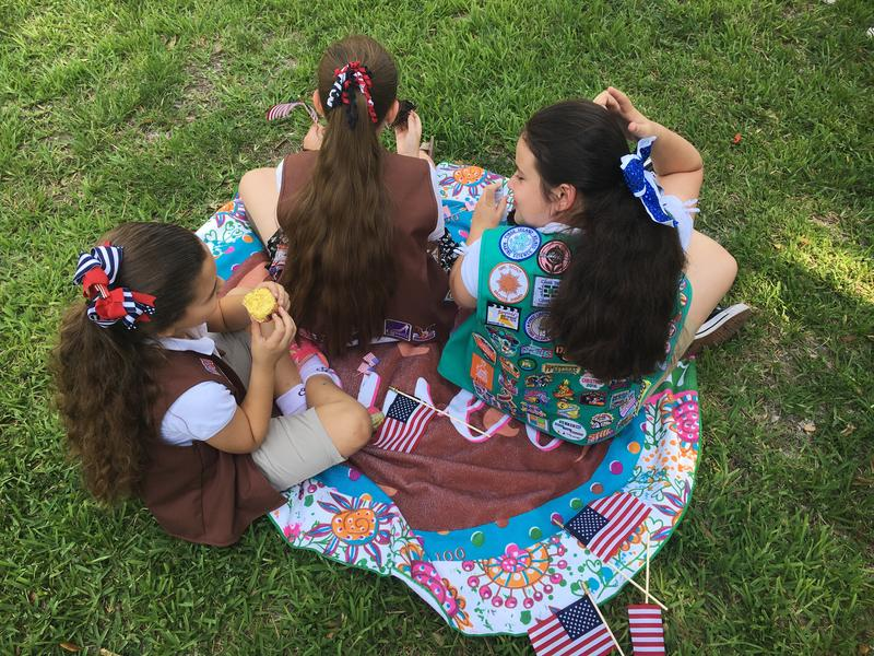 Miami Springs Girl Scouts watch the Memorial Day ceremony on Sunday morning. Local Girl Scout and Boy Scout troupes attend the annual service on Curtiss Parkway.