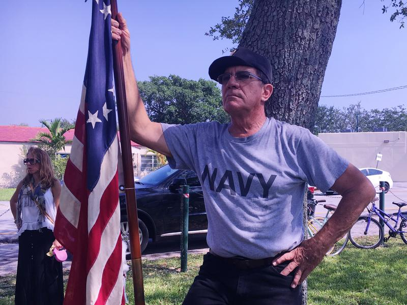 Ralph Wakefield, 70, holds and American flag during the Memorial Day ceremony in Miami Springs, where he lives. Wakefield served in the U.S. Navy in Vietnam on the flight deck of the U.S.S. Independence.