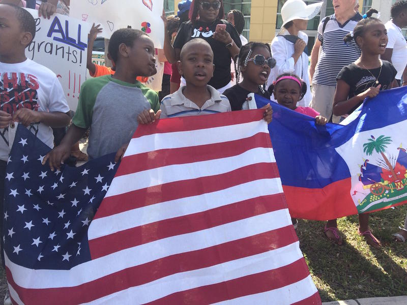 People of all ages gathered in front of the USCIS office on 7th Avenue in Miami.