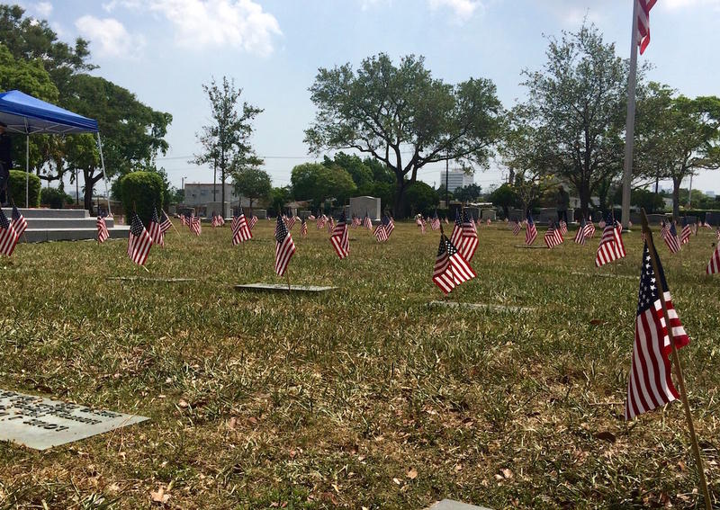 More than 2000 miniature flags were placed on graves throughout Woodlawn Park Cemetery.