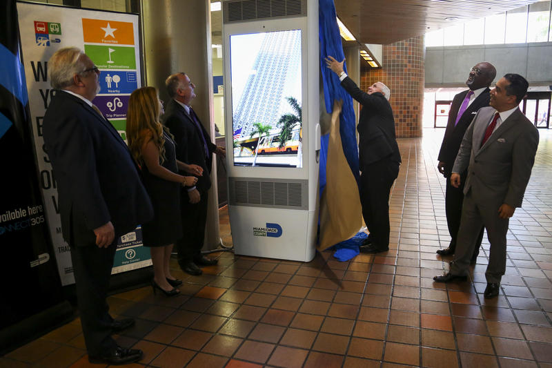 "Carlos Gimenez, mayor of Miami-Dade County, unveils a new ""Connect 305"" kiosk installed Tuesday in Government Center."