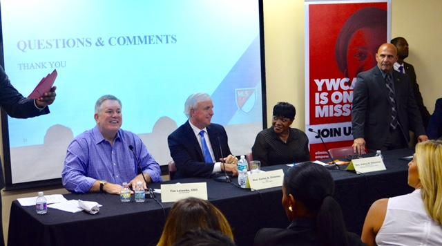 Tim Leiweke (left), Miami-Dade County Mayor Carlos Gimenez (center), and  Miami-dade Commissioner Audrey M. Edmonson (right), listening to residents and answering their questions.