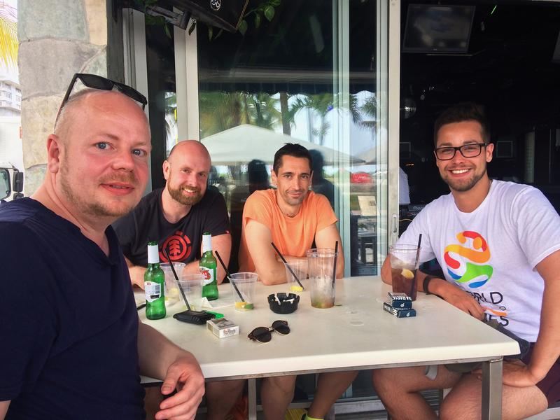 From left, badminton athletes Martin Hansen, Jens Doerge, and Alberto Miguel, and friend Lionel Olivera gathered at the Palace to discuss the news.
