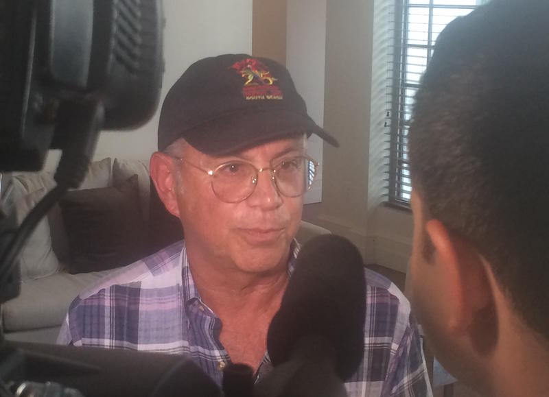 Mango's owner David Wallack speaks to reporters about proposed restrictions on late night liquor sales on Ocean Drive.