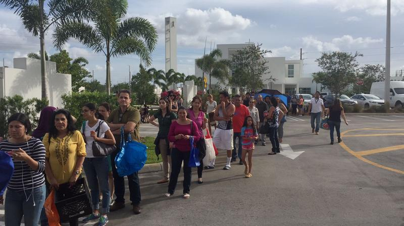 Recently arrived Venezuelan immigrants lining up at Our Lady of Guadalupe church in Doral for food and assistance.