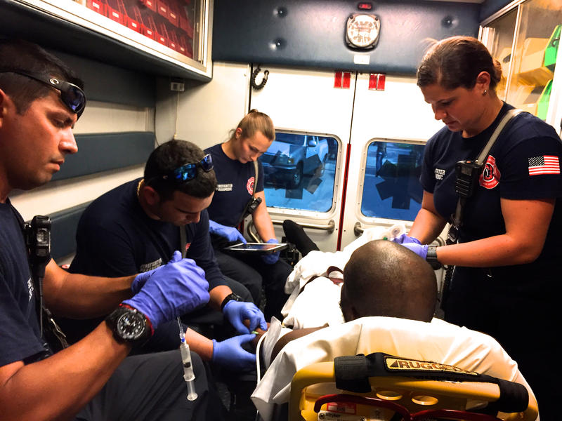 Delray Beach Fire Rescue firefighter-paramedics treat a patient in transit to Delray Medical Center on May 19, 2017.