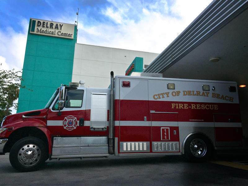 "A Delray Beach Fire Rescue team delivers a patient to Delray Medical Center on May 19, 2017. A ""rescue truck"" is comparable to an ambulance in form and function."