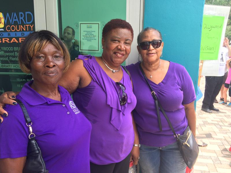 Cynthia Mitchell, center, attended the rally with women from her church.