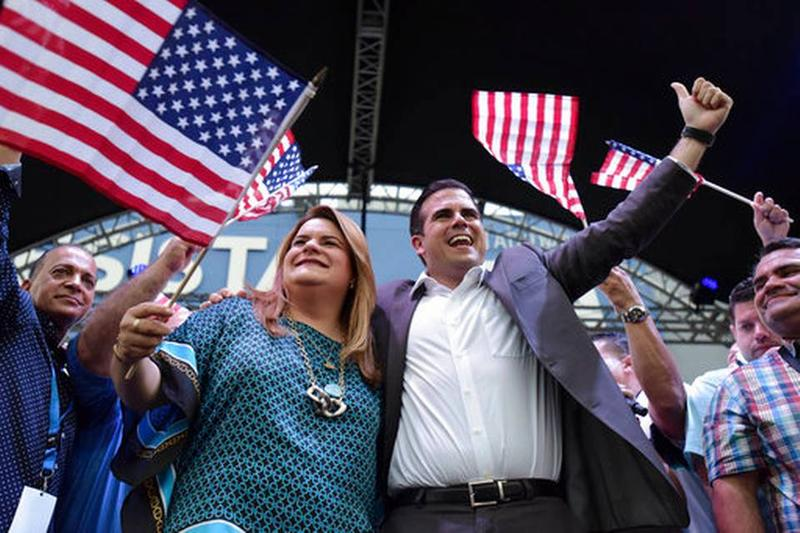 Puerto Rico Governor and statehood supporter Ricardo Rossello (right) and Puerto Rico's resident commissioner in Washington, Jenniffer Gonzalez, celebrate victory in Sunday's referendum.