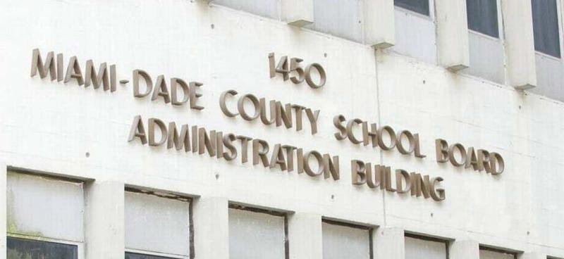 The Miami-Dade School Board has been sued by two students who say their Social Security numbers were posted on a district website.