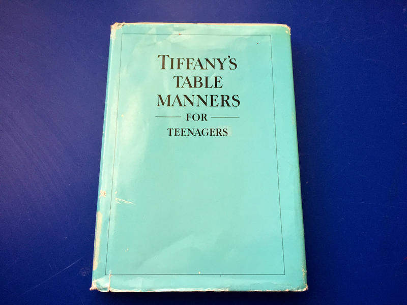 """Ms. Hinson teaches from the text """"Tiffany's Table Manners for Teenagers,"""" which she found while browsing used books."""