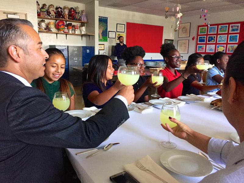 Guatemalan consul Mario René Azmitia raises a glass to toast fifth graders at high tea at South Grade Elementary in Lake Worth. May 22, 2017.