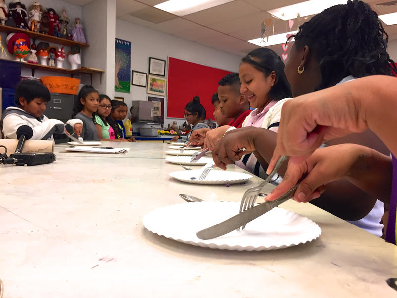 Students practice formal table etiquette once a week for seven weeks in Ms. Hinson's art class.