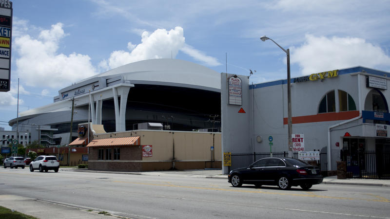 Local businesses in Little Havana will wait to serve prospective clients, across the street from the Miami Marlins stadium.