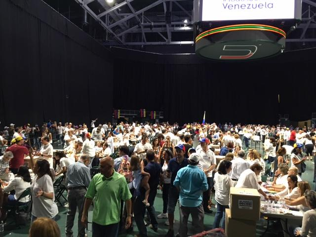 Voters walked into the Watsco Center in Coral Gables to lines of tables where they could sign in and vote.