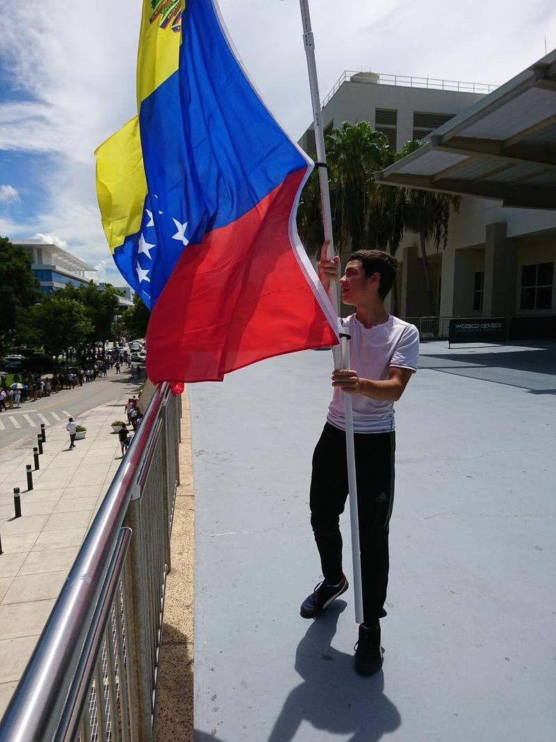 People in line cheered at the sight of the Venezuelan flag outside of the UM's Watsco Center.
