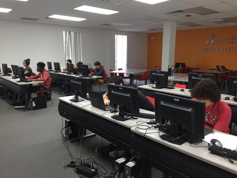 Students at the Big Brother Big Sister headquarters focused on video game coding during their six-week boot-camp.