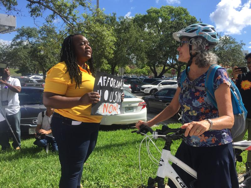 Daniella Pierre engages with a community member during the rally.
