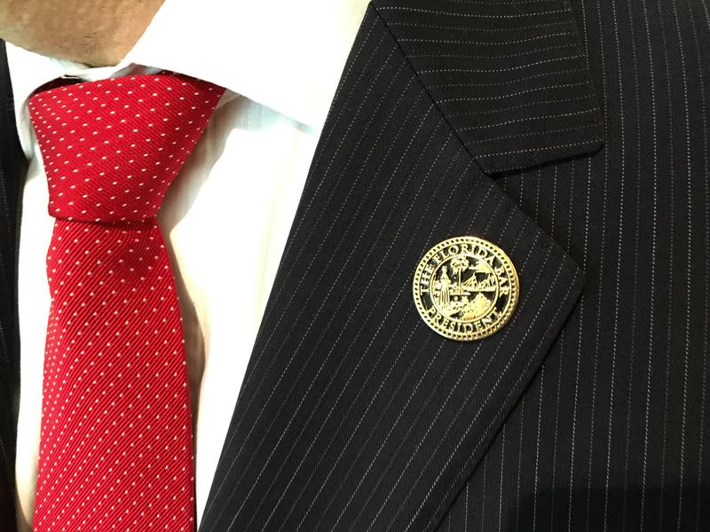 The Florida Bar President pin is passed down to each new president.