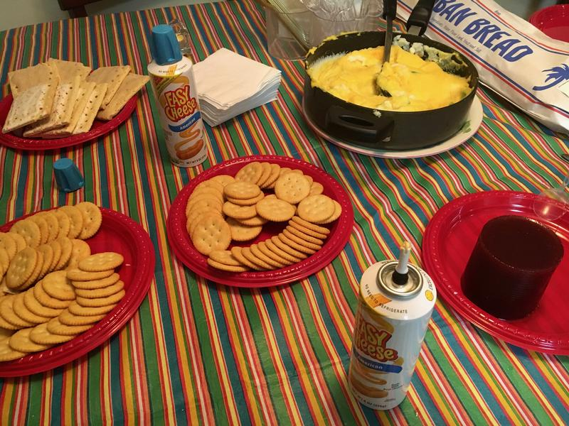 A spread of Blanco's favorite foods as a kid struggling with a Cuban-American identity: crackers with spray cheese, Pop Tarts, cranberry sauce and instant mashed potatoes with Badia seasoning and green pepper.