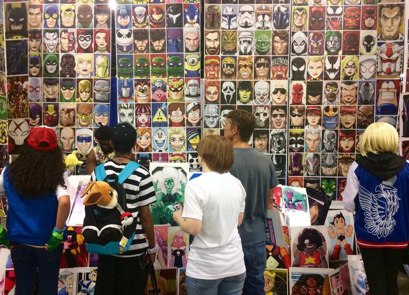 Terry Huddleston sells his comic-themed artwork at one of Supercon's hundreds of booths.