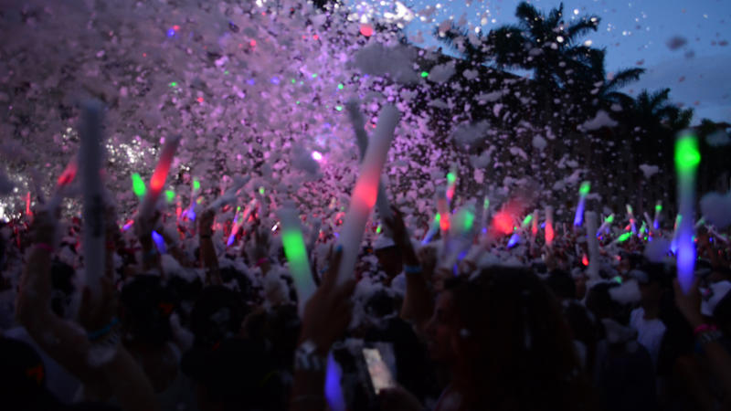 SummerFest antendees cheer as they are sprayed with foam water from the stage –  with is 99% and 100% natural according to the event's website
