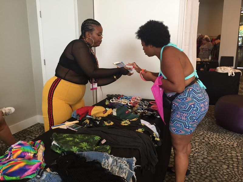 A  customer shops at the Curves Week Martetplace, which allowed locals to try on clothes from plus-sized vendors they might otherwise only be able to find online.