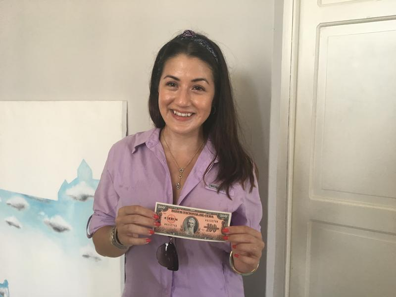 Kelsie Aguilera, one of the participants, with a 100-peso note that has the image of her great-great grandfather, Francisco Vicente Aguilera. He was a patriot and revolutionary who helped free Cuba from Spanish rule.