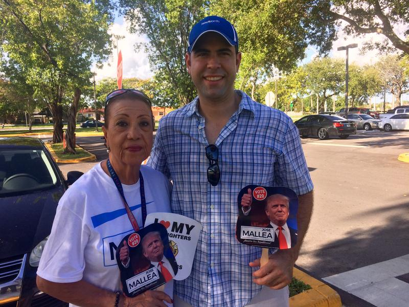 Luis Perez Codina and Mirium Cajiga staked out a spot in the parking lot at West Dade Regional Library to support Jose Mallea. Cajiga is Mallea's aunt.