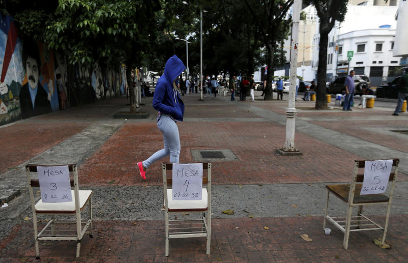 A voter leaves a poll station after casting her ballot for the election for a constitutional assembly in Caracas, Venezuela, on Sunday.