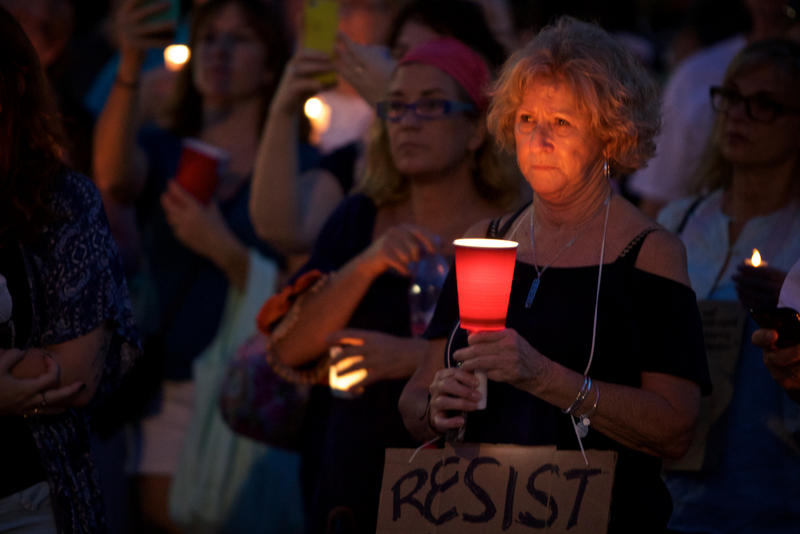 Crowds gathered throughout South Florida, including in Miami's Bayfront Park, for vigils after the weekend violence in Charlottesville, Virginia. In the picture, the vigil at Centennial Square in downtown West Palm Beach.