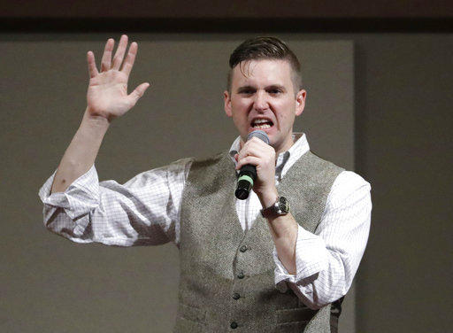 In this Dec. 6, 2016, file photo, Richard Spencer, who leads a movement that mixes racism, white nationalism and populism, speaks at the Texas A&M University campus in College Station, Texas.