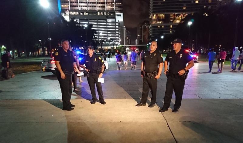 City of Miami police estimates that between 150 and 200 people participated in the vigil in downtown Miami.