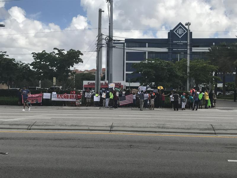 The activists lined NW 36th St. outside of Rep. Diaz-Balart's Doral office.