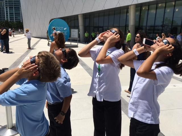 Early dismissal in South Florida schools allowed many families to enjoy the eclipse together.