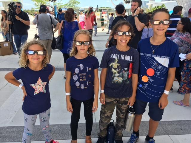 Siblings Mariela, 7; Giana, 9; Ivan, 11 and Julian, 13, chose t-shirts with astronomy themes to go watch the eclipse at the Frost Science Museum.