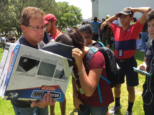 Jay Baldwin brought his own solar eclipse viewer to share with students and families who didn't have protective glasses at FIU.