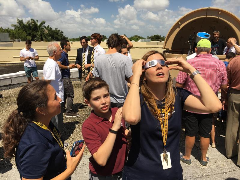 Ana Suárez and her son Antonio watch the eclipse from the third floor observatory at Belen Jesuit Preparatory School.