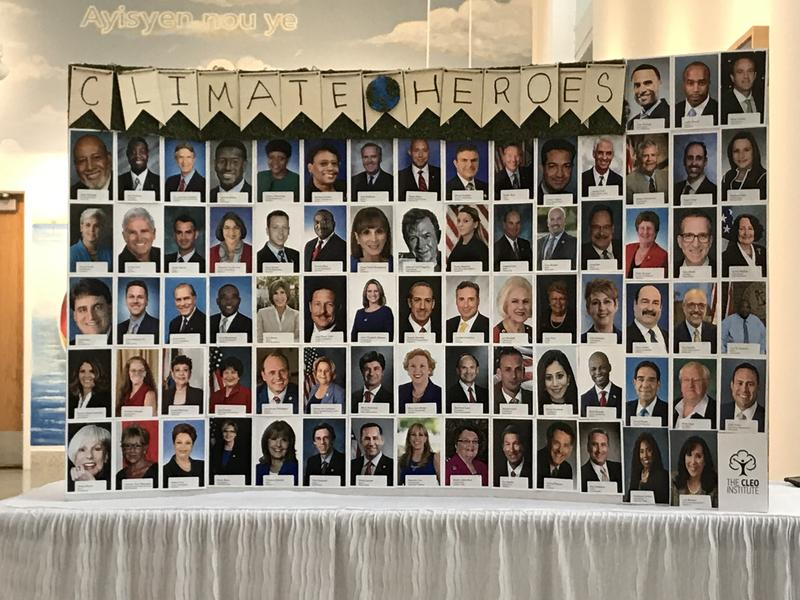 "A display at the ""Climate-Conscious Candidates Celebration"" featured photos of the more than 70 Florida elected officials being honored."