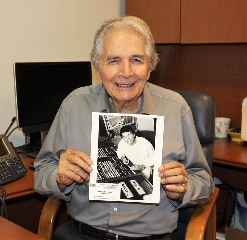 Frank Loconto poses with a picture of himself in 1992.